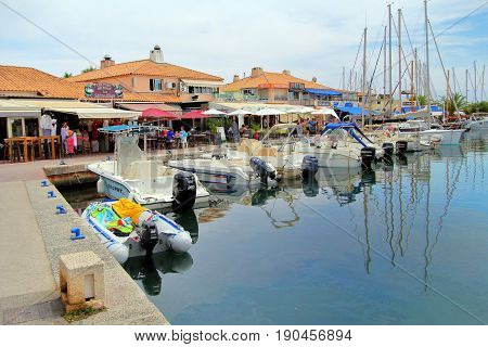 Le Lavandou, Provence, France - August 18 2016: Small Motor Launces And Sailing Boats Morred Next To