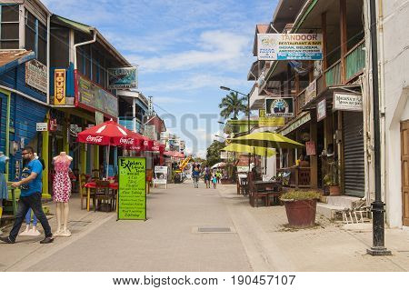 San Ignacio Belize March 1 2017: Main tourist street Burn's Avenue with restaurants souvenir shops and tours in the city of San Ignacio Belize in Central America