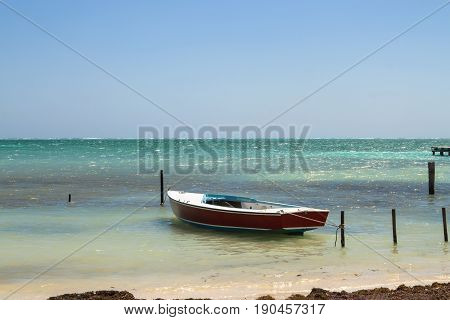 Beautiful tropical water with boat on the island of Caye Caulker on the Barrier Reef in the sparkling Caribbean Sea