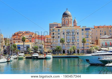 St Raphael, Provence, France - August 21 2016: View From The Marina Of The Towers Of The Basilique N