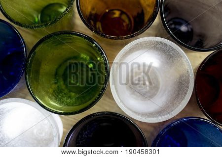 series of colored glasses with top view