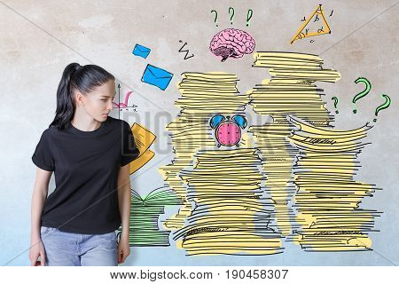 Thoughtful young european woman on concrete background with drawn paperwork pile. Workload concept
