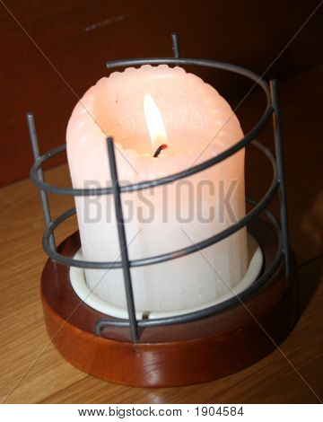 Candles Flicker On A Hardwood Shelf