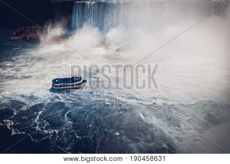 boat with tourists in Niagara Falls in sumer