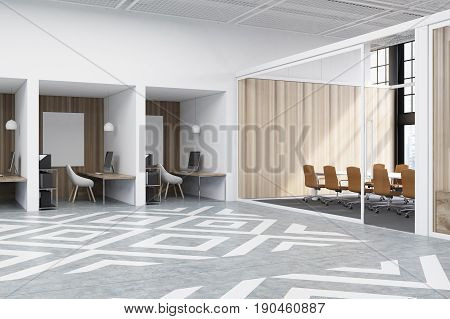 Office cubicles in an office with white and wooden walls. There are blank vertical pictures in each of them a desk with a computer a chair and shelves. Side view. 3d rendering mock up