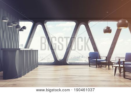 Side view of a black wave reception desk is standing near a black wall in a room with wooden floor and original windows with triangular frames. 3d rendering mock up toned image