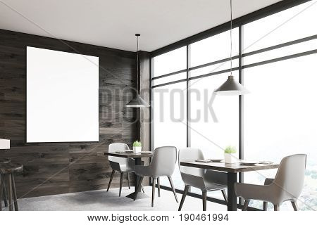 Dark wooden cafe interior with square tables white chairs standing along a panoramic window and a framed vertical poster on a wall. 3d rendering mock up
