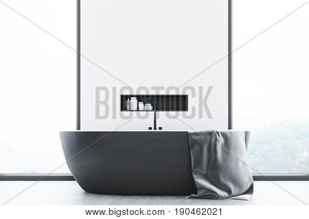 Close up of a white modern bathroom interior with a gray tub standing near a window a large towel hanging on its side and a shelf with cleaning products in the wall. 3d rendering mock up