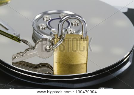 Harddrive with padlock and keys in detail