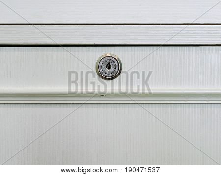 White Wooden Carbinet Drawer With Locked Key Hole.