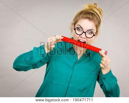 Business Woman Biting Pencil