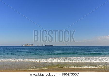 View of sea horizon line and Cagarras islands in front off Ipanema beach in Rio de Janeiro