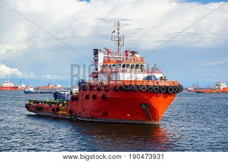 Labuan,Malaysia-Feb 19,2017:Offshore supply vessels transporting cargo at Labuan,Malaysia.The number of oil & gas companies operating on the duty-free island of Labuan is booming despite the slump in crude oil prices.