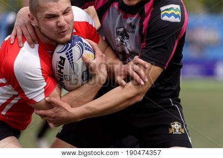 ST. PETERSBURG, RUSSIA - MAY 27, 2017: Match Busly, Belarus (red and white shirts) vs Livonia, Latvia during Rugby Europe Sevens Club Champion's Trophy.