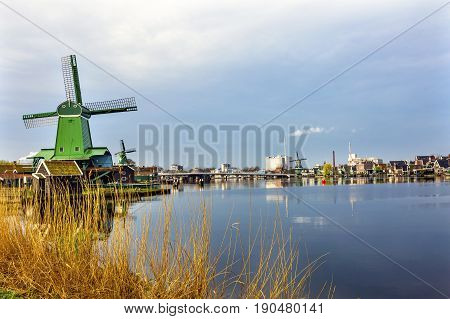 Wooden Windmills Modern Industry Zaanse Schans Old Windmill Village Countryside Holland Netherlands. Working windmills from the 16th to 18th century on the River Zaan. Windmills powered industries in Holland such as ship builidng vegetable oil production.