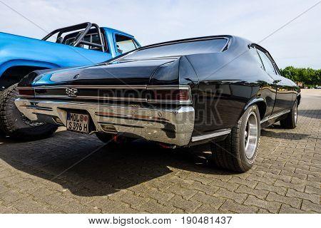PAAREN IM GLIEN GERMANY - JUNE 03 2017: Mid-size car Chevrolet Chevelle SS396 Hardtop Coupe 1966. Rear view. Exhibition