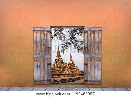 Open the door to see the old pagoda