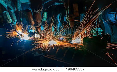 Industrial welding robots are movement in production line factory