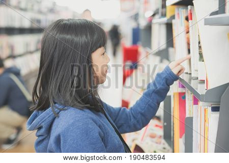 Portrait of beautiful Asian girl in a bookstore