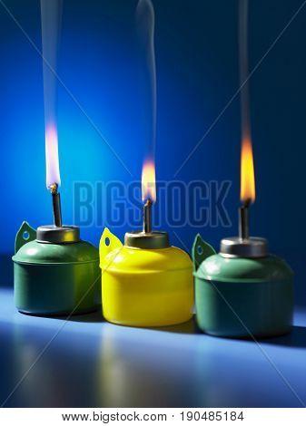 pelita burning oil lamp on blue background