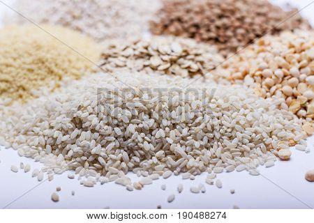 Heap of couscous rice pea grits oatmeal lentil.