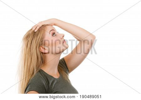 Blonde Woman Holding Hand On Hair