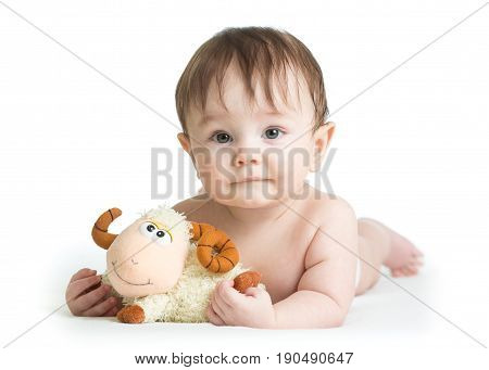 baby boy lying on his tummy with lamb toy