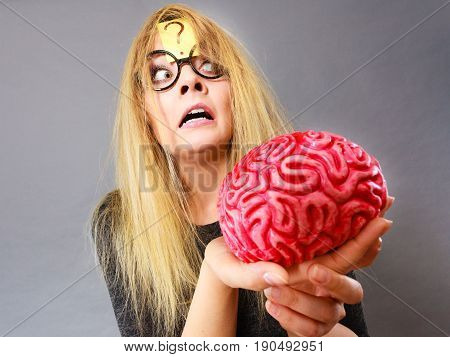 Weird Woman Holding Brain Having Idea