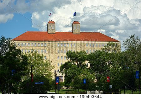 LAWRENCE KS USA - May 30 2017: The University of Kansas Fraser Hall building sits atop Mount Oread and is the highest point on campus. It is home to the anthropology sociology and psychology departments.