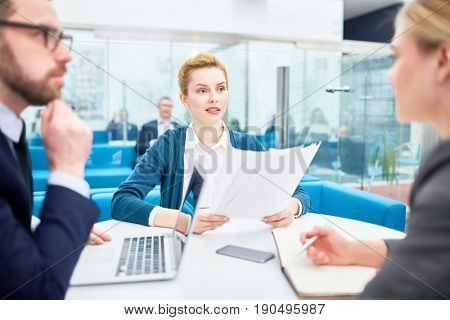 Employers listening to applicant at interview