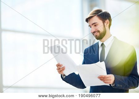 Happy ceo reading papers or contracts