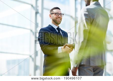Happy employer greeting new manager