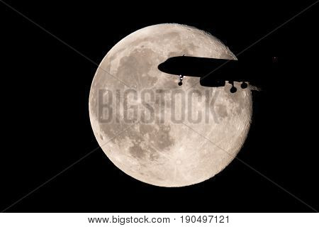 Moon intercepted by an airplane about to land