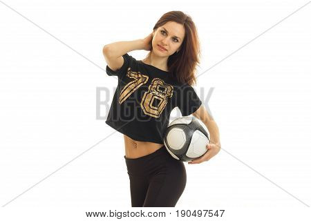 slender sport girl stands in the Studio and holding a soccer ball isolated on white background