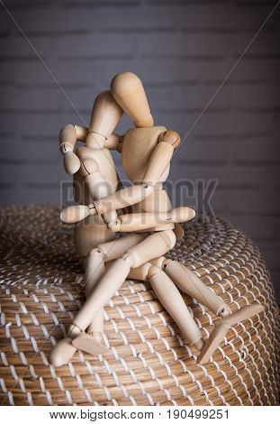 Two Lovers wooden man tenderly cuddling indoors
