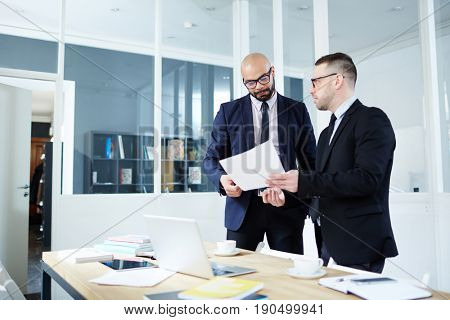 Employer showing business contract to co-worker