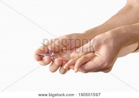 Human Hand Holding Scissors Trim Child Fingernail