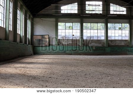 Beautiful natural lights in empty riding arena is suitable for dressage horses without people