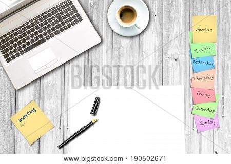 office top view with paper note blank paper notebook and cup of coffee business background concept