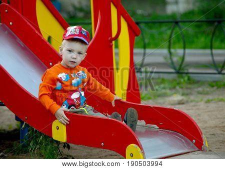 Boy Riding On The Playground