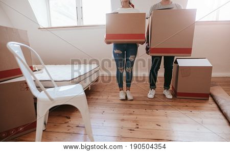 Couple With Cardboard Boxes Moving To New House