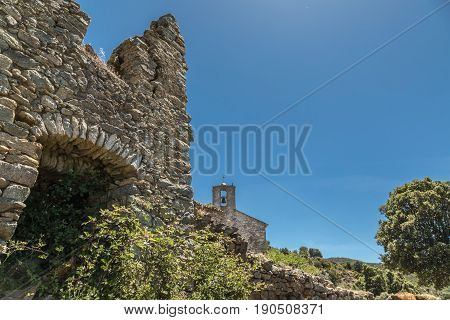 Derelict Buildings And Chapel In Abandoned Village In Corsica