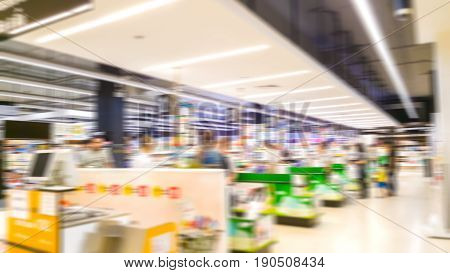 Abstract blur cashier area with people waiting checkout and pay money background in big supermarket store
