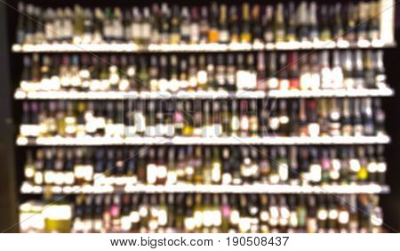 Abstract blur wine and beer shop on the store shelves background of people shopping in supermarket store