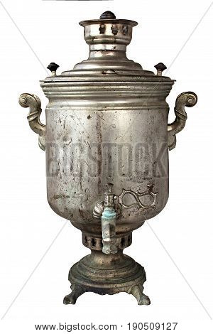 Vintage soot grunge metal tea samovar on white background. The samovar was used for a long time. Burned with firewood