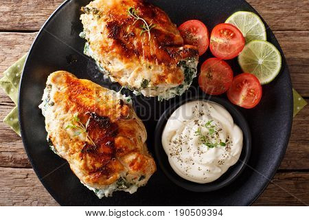 Baked Chicken Fillet Stuffed With Cheese And Spinach With Sauce Close-up. Horizontal Top View