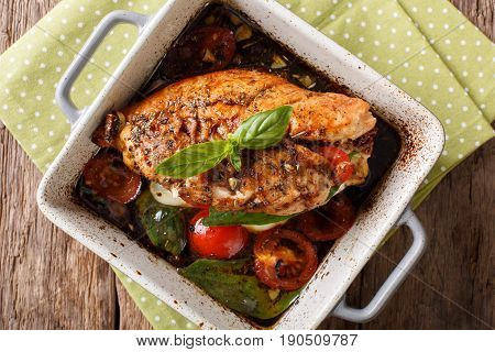 Delicious Chicken Fillet Baked With Caprese Close-up In A Baking Dish. Horizontal Top View