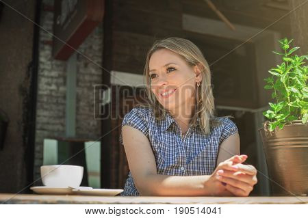 Woman drinking coffee in the morning at restaurant soft focus on eyes.