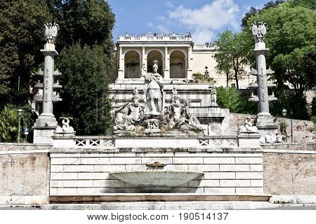 Rome, Italy - March 16, 2017: Dea Roma between the Tiber and the Aniene, fountain on the east side of Piazza del Popolo, against the steep slope of the Pincio