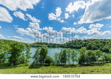 Great Green Water German Lake In A Vulcan  With Amazing Clouds In A Sun Shinning Day - Maar Lakes